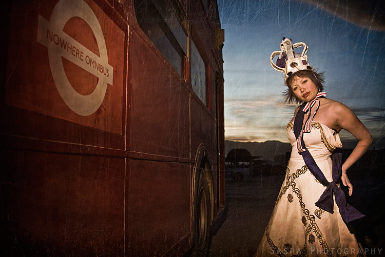 The Queen poses next to the Nowhere Omnibus.