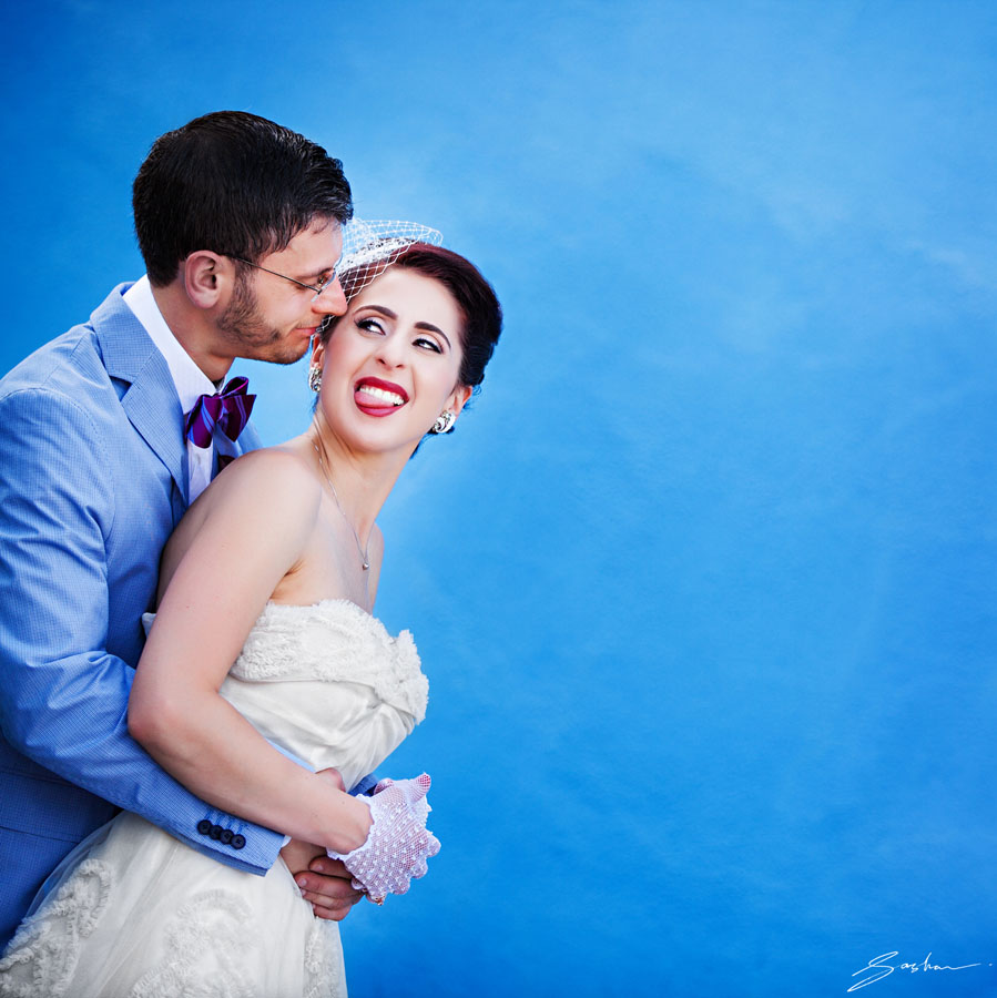 bride groom blue wall