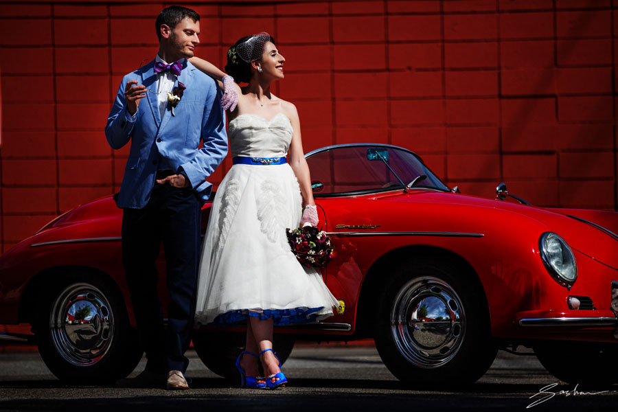 bride groom red sportscar