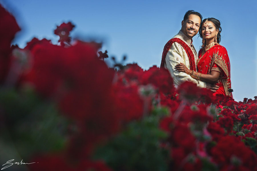 indian wedding couple red sari