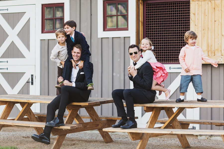 candid portrait of two grooms with children
