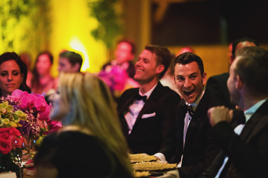 two grooms laughing
