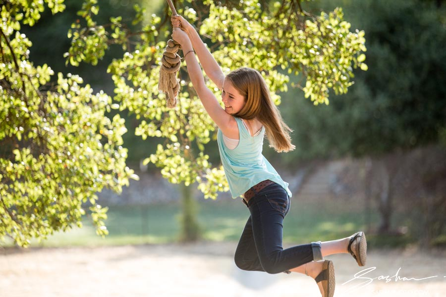 girl on a rope swing