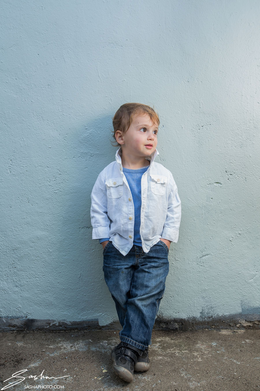 toddler portrait blue wall