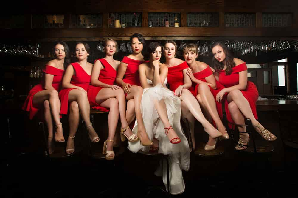 bridal party in red dresses
